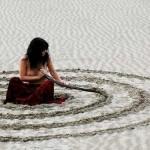 woman spiral sand