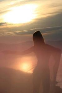 dancing woman at sunset